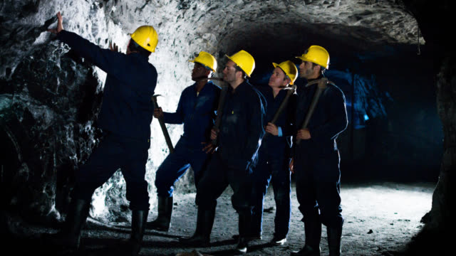 Group of miners working at a mine Group of miners working at a mine - underground mining concepts mining natural resources stock videos & royalty-free footage
