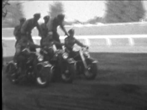Group of motorcycle stunt riders--From 1930's film video