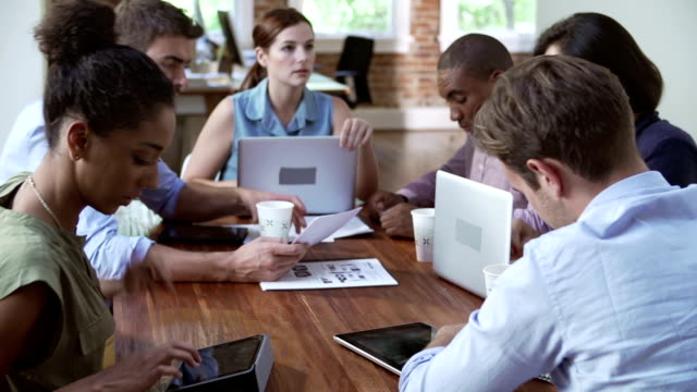 Group Of Office Workers Meeting To Discuss Ideas video