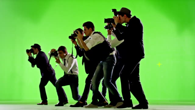 Group of paparazzi. Photo shoot on green screen. Slow motion. Shot on RED EPIC Cinema Camera.