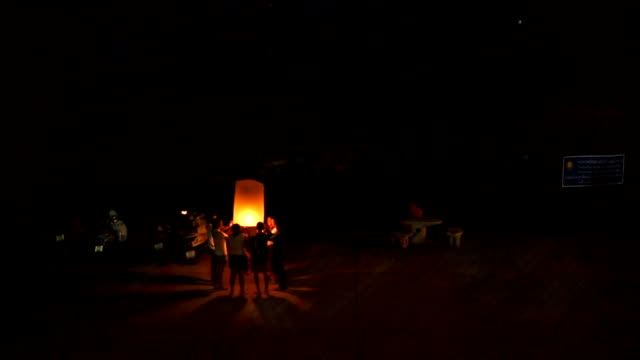 group of people and lantern,the end of buddhist lent day,thailand - sky lantern stock videos and b-roll footage