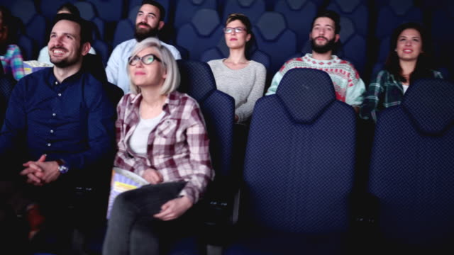 Group of people are in cinema and watching movie video