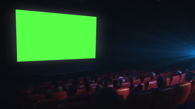group of people are watching a green screen mock-up film screening in a movie cinema theater. - film impreza rozrywkowa filmów i materiałów b-roll