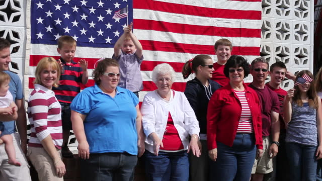 Group of people by American flag waving video