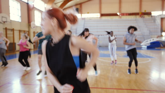 Group of people Dancing on Zumba Class Group of people Dancing on Zumba Class dance studio stock videos & royalty-free footage