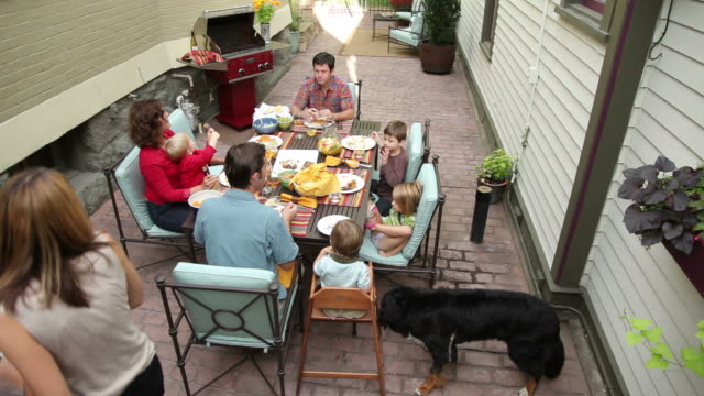 Group of people eating at outdoor dinner party video
