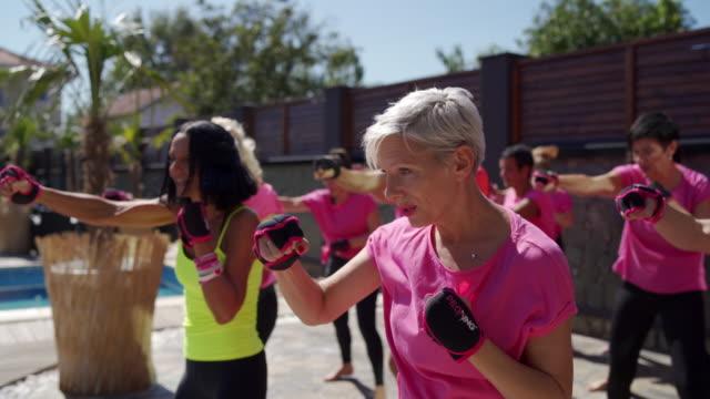 Group of people enjoying boxing exercises