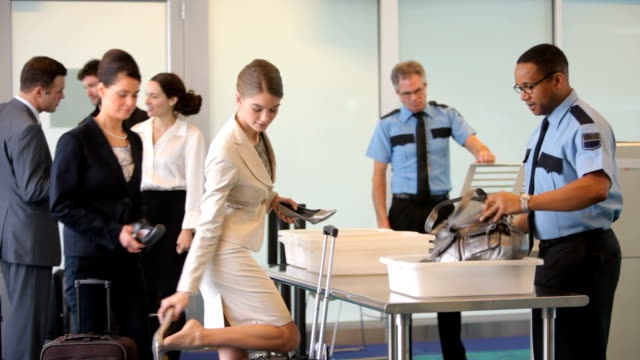 group of people go through security at airport - säkerhet bildbanksvideor och videomaterial från bakom kulisserna