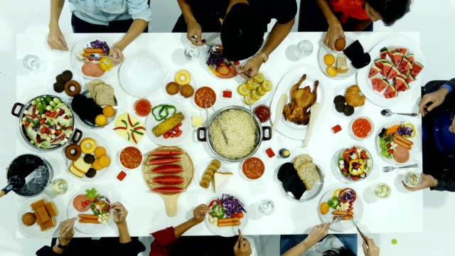 group of people having dinner together at party. people with new year party concept. - фуршет стоковые видео и кадры b-roll