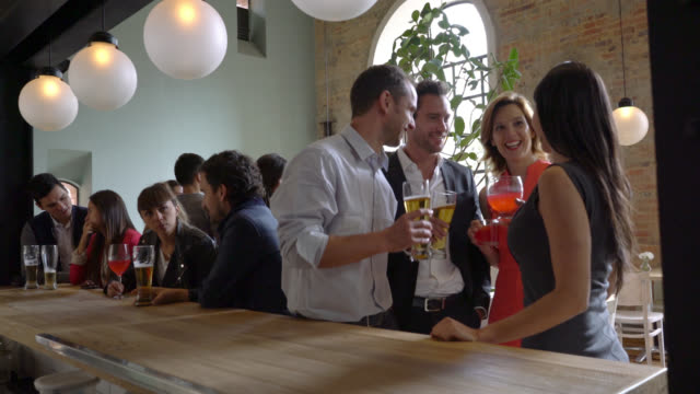 Group of people having drinks after work video