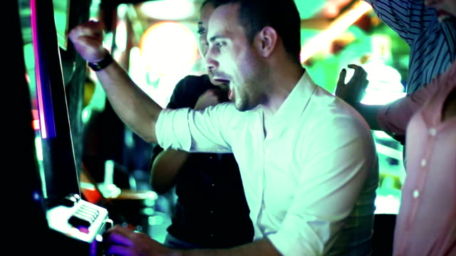 Group of people having fun in casino. video
