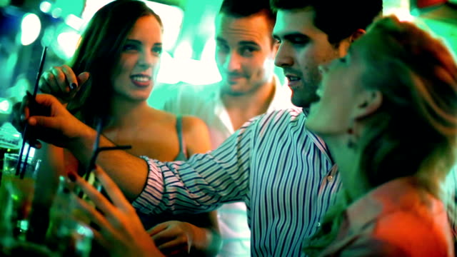 Group of people having fun on a night out. video