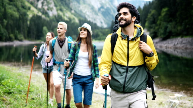 Group of people hikers walking in mountains