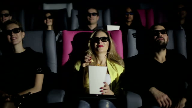 Group of people in 3D glasses watching movie at cinema video
