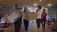 istock Group of people moving office 1192163007