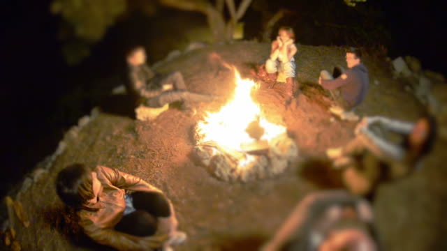 Group of people on a campfire circle video