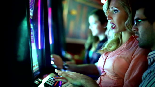 Group of people playing slots.
