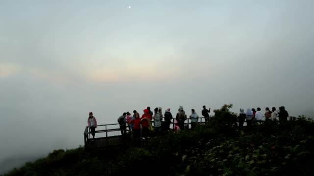 Group of people relax and enjoy beautiful panorama of mountain video