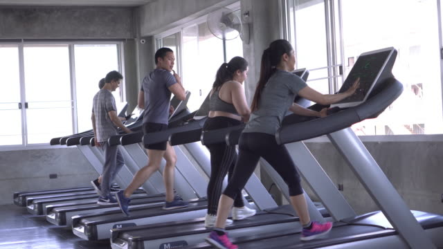 Group of people running People in gym health club stock videos & royalty-free footage