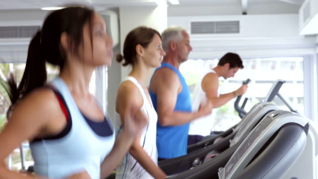 Group Of People Using Running Machines video