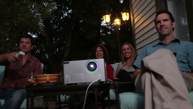 Group of people watch movie outdoors video