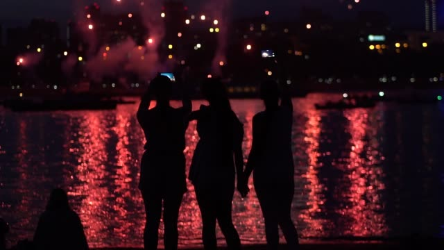 A group of people with a good mood during the fireworks. slow motion