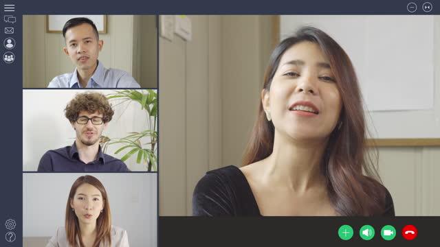 自宅やオフィスで働く人々のグループは、オンライン、ウェビナーまたは距離会議の画面上のウェブカメラグループのビデオ通話会議技術の同僚と話しています。 - 人里離れた点の映像素材/bロール