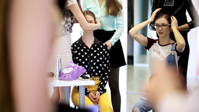 Group of pretty women is busy with smartening up in dressing room video