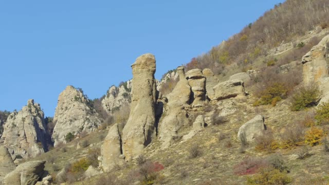 A group of rocks in mountains of Asia. Shot. Beautiful landscape and clear blue sky video