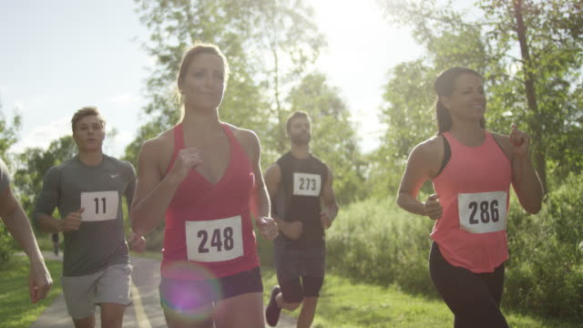 Group of runners running outside