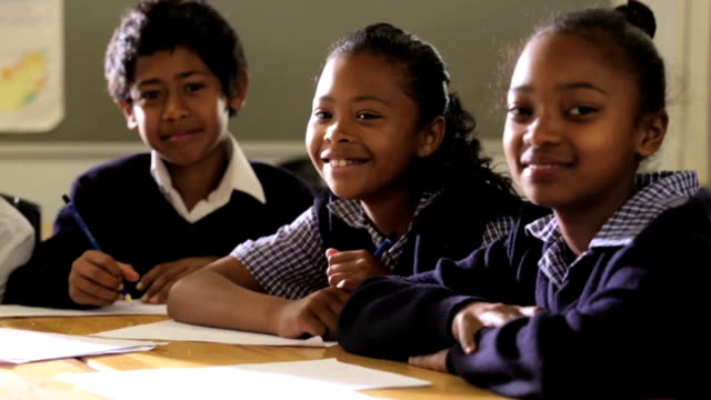 Group of school children smiling to camera video