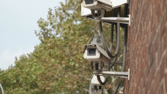 Group of Security Cameras on Side of City Building video
