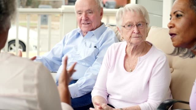 group of senior adults discuss something during support group meeting - memories stock videos & royalty-free footage