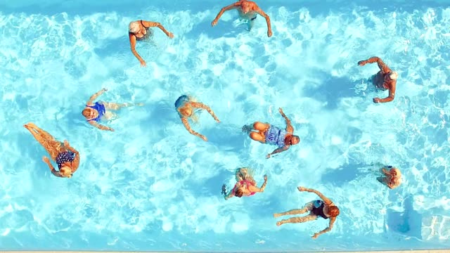 Group of seniors swimming in a pool video