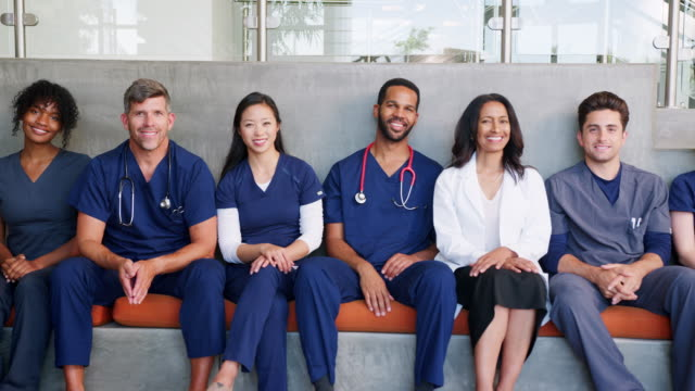 Group of smiling male and female healthcare professionals Group of smiling male and female healthcare professionals group of people stock videos & royalty-free footage