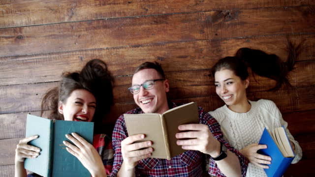 group of students reading book at school video