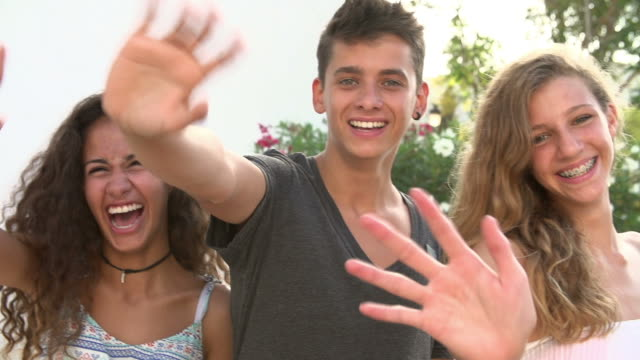 Group Of Teenage Friends Waving At Camera In Slow Motion video