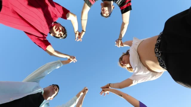 Group of teenagers embracing together video