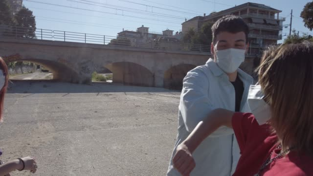Group of teenagers wearing protective face masks - video