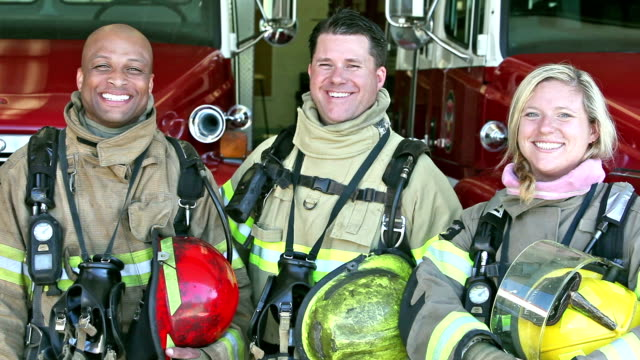 group of three multi-ethnic firefighters at the station - firefighter stock videos and b-roll footage