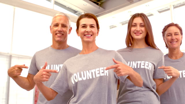 Group of Volunteers pointing at shirts video