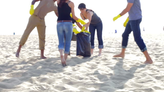 Group Of Volunteers Tidying Up Rubbish On Beach video