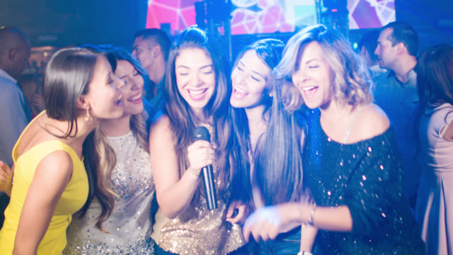 group of women singing at a karaoke bar - bachelorette party stock videos and b-roll footage