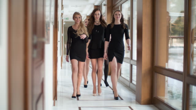 Group of women walking in office corridor video