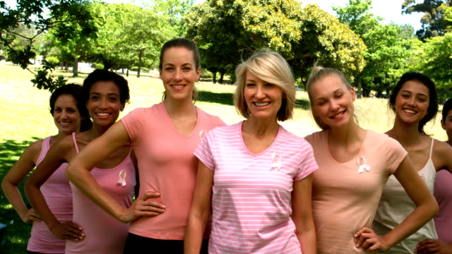 Group of women wearing pink for breast cancer in park video