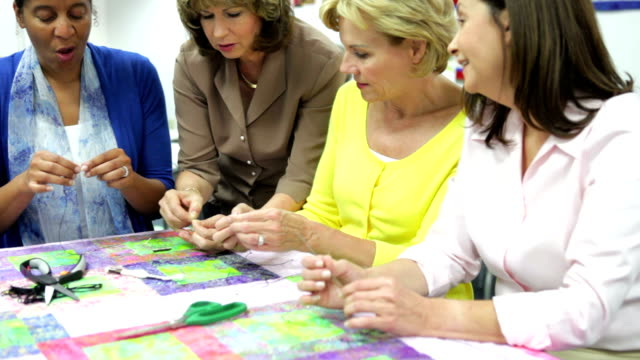 Group Of Women Working On Quilt Together video