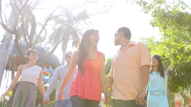 Group of young adults walk through city video