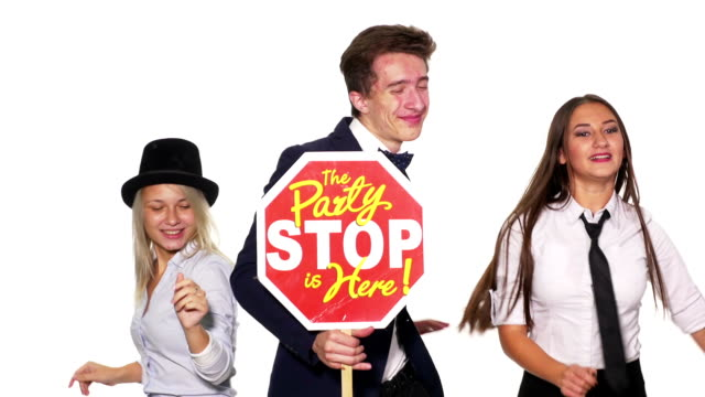 Group of young friends dancing and holding the party is here sign Group of young friends dancing and holding the party is here sign prop stock videos & royalty-free footage