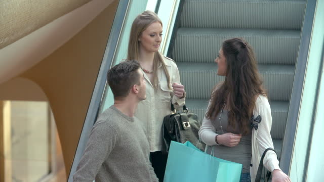Group Of Young Friends Riding Escaltor In Shopping Mall video