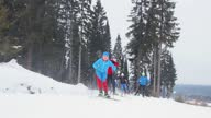 istock Group of young people are skiing 1307745747